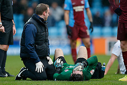 Substitute Goalkeeper James Severn of Scunthorpe United is treated on the floor for an injured arm after challenging Matt Smith of Bristol City, having to be taken off and replaced with outfield player Andrew Boyce - Photo mandatory by-line: Rogan Thomson/JMP - 07966 386802 - 17/01/2015 - SPORT - FOOTBALL - Scunthorpe, England - Glanford Park - Scunthorpe United v Bristol City - Sky Bet League 1.