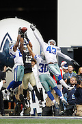 A gang of Dallas Cowboys break up a pass intended for New Orleans Saints wide receiver Marques Colston (12) in the end zone at Cowboys Stadium in Arlington, Texas, on December 23, 2012.  (Stan Olszewski/The Dallas Morning News)