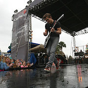 Country singer Hunter Hayes performs a pre-game concert in the Fan-Zone prior to the NCAA Capital One Bowl football game between the South Carolina Gamecocks and the Wisconsin Badgers at the Florida Citrus Bowl on Wednesday, January 1, 2014 in Orlando, Florida. (AP Photo/Alex Menendez)
