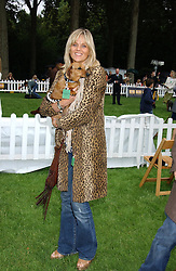 LINDA BARKER and her dog Lilly at the 3rd annual Macmillan Dog Day in aid of Macmillan Cancer Relief held at Royal Hospital Chelsea, London SW3 on 5th July 2005.<br /><br />NON EXCLUSIVE - WORLD RIGHTS