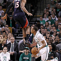 10 May 2012: Atlanta Hawks center Al Horford (15) jumps next to Boston Celtics shooting guard Avery Bradley (0) during the Boston Celtics 83-80 victory over the Atlanta Hawks, in Game 6 of the Eastern Conference first-round playoff series, at the TD Banknorth Garden, Boston, Massachusetts, USA.