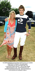 The MARCHIONESS OF MILFORD HAVEN and her son JAMES WENTWORTH-STANLEY, at a polo match in Berkshire on 12th June 2004.PWC 155