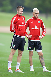 CARDIFF, WALES - Saturday, June 4, 2016: Wales' Chris Gunter and Aaron Ramsey during a training session at the Vale Resort Hotel ahead of the International Friendly match against Sweden. (Pic by David Rawcliffe/Propaganda)