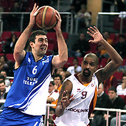 Galatasaray's Preston Shumpert (R) and Turk Telekom's Nedim Yucel (L) during their BEKO Basketball League match Galatasaray between Turk Telekom at the Abdi Ipekci Arena in Istanbul at Turkey on Sunday, December 25 2011. Photo by TURKPIX