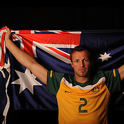 Australia Socceroos  Captain Lucas Neill  with an Australia flag Flag  during a studio shoot before the match with New Zealand in Melbourne as they prepare for world cup in South Africa . 21st May 2010 . Photo Tim Clayton