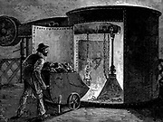 Charging a blast furnace at the Govan Iron Works, Scotland. Charge fed into cup around cone, as cone lifted the charge fell into top of furnace. Molten metal run off when furnace tapped at bottom. Wood engraving c1885.