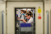 Commuters wearing face surgical masks to curb the spread of Coronavirus are traveling on Jubilee Line (eastbound) in Westminster station, central London on Wednesday, Oct 14, 2020. The UK has recorded 12,872 more coronavirus cases and 65 deaths in the latest daily government update. It marks a slight fall from last Saturday when 15,166 cases and 81 deaths were recorded. The UK's coronavirus death toll now stands at 42,825. (VXP Photo/ Vudi Xhymshiti)