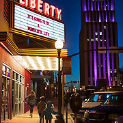 Children run down the sidewalk in front of the Liberty Theatre in Tyler, Texas. Nathan Lambrecht/Journal Communications