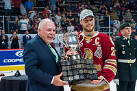 REGINA, SK - MAY 27:  CHL president David Branch stands congratulates Jeffrey Truchon-Viel #25 of Acadie-Bathurst Titan on winning the Memorial Cup trophy at centre ice at Brandt Centre - Evraz Place on May 27, 2018 in Regina, Canada. (Photo by Marissa Baecker/CHL Images)