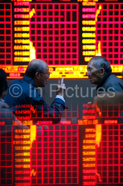 Investors monitor and trade stocks at a securities exchange house in Shanghai, China on Thursday, 25 November 2010. Despite the country's robust economy, China's stock market has not been kind to the ordinary investors, it is one of the worst performing major markets in recent years.