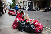 Rubbish and recycling bags left on the street in London, England, United Kingdom. Collection of recyclable waste is the city is important business, while doesnt always make the streets look clean.