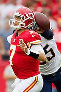 KANSAS CITY, MO - SEPTEMBER 30:  Matt Cassel #7 of the Kansas City Chiefs is hit by Shaun Phillips #95 of the San Diego Chargers at Arrowhead Stadium on September 30, 2012 in Kansas City, Missouri.  The Chargers defeated the Chiefs 37-20.  (Photo by Wesley Hitt/Getty Images) *** Local Caption *** Matt Cassel; Shaun Phillips Sports photography by Wesley Hitt photography with images from the NFL, NCAA and Arkansas Razorbacks.  Hitt photography in based in Fayetteville, Arkansas where he shoots Commercial Photography, Editorial Photography, Advertising Photography, Stock Photography and People Photography
