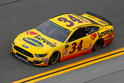 February 9, 2019 - Daytona, FL, U.S. - DAYTONA, FL - FEBRUARY 09: Michael McDowell, driver of the #34 Front Row Motorsports Love's Travel Stops Ford Mustang, during Daytona 500 practice on February 9, 2019 at Daytona International Speedway in Daytona Beach, Fl. (Photo by David Rosenblum/Icon Sportswire) (Credit Image: © David Rosenblum/Icon SMI via ZUMA Press)