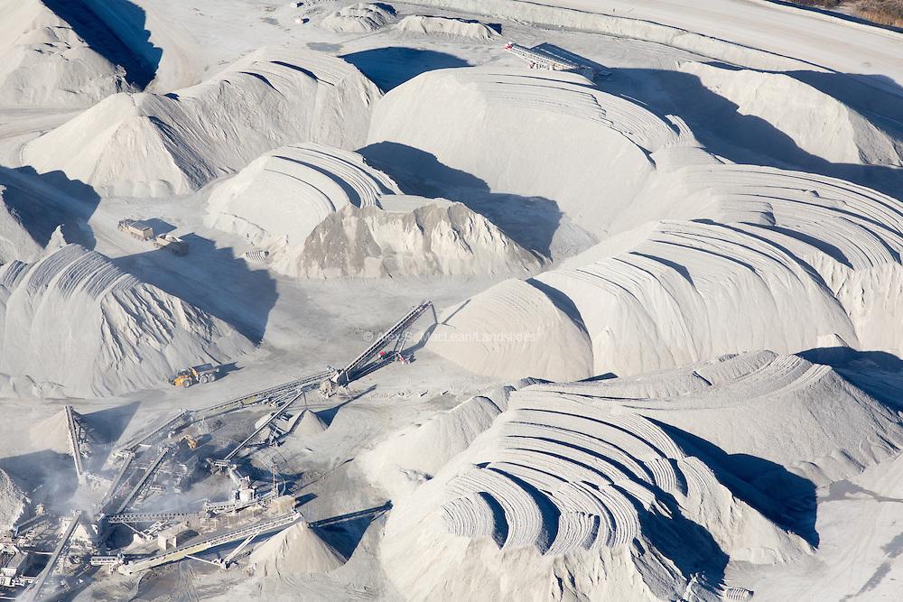 Mining upper layers of sandy earth near a tar sands mine in Alberta