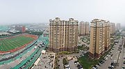 Huge construction and recently built tower blocks in Tongzhou city on the outskirts of Beijing. All the old buildings, villages have been destroyed to make way for the mega cities of today