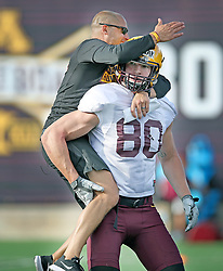 August 4, 2017 - Minneapolis, MN, USA - Gophers Head Coach P.J. Fleck jumped on Nate Wozniak during after a play during the Gophers football practice at Gibson-Nagurski Football Complex, Friday, August 4, 2017 in Minneapolis, MN.    ]  ELIZABETH FLORES • liz.flores@startribune.com  (Credit Image: © Elizabeth Flores/Minneapolis Star Tribune via ZUMA Wire)