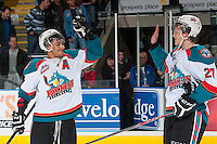 KELOWNA, CANADA - MARCH 28: Tyrell Goulbourne #12 and Ryan Olsen #27 of the Kelowna Rockets high five one another on the series win on March 28, 2014 after the Rockets win game 5 of the first round of WHL Playoffs and take the series 4-1 at Prospera Place in Kelowna, British Columbia, Canada.   (Photo by Marissa Baecker/Getty Images)  *** Local Caption *** Tyrell Goulbourne; Ryan Olsen;