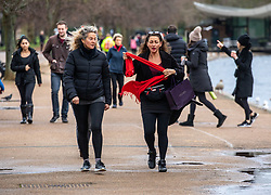 © Licensed to London News Pictures. 19/01/2021. London, UK. Members of the public walking in Hyde Park wrap up against the wind and rain as Storm Christoph is set to batter the UK with the Met office issuing a yellow weather warning for the South East today and tomorrow. Photo credit: Alex Lentati/LNP