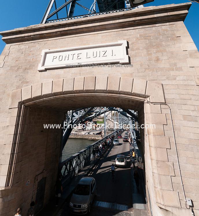 Street and entrance gate to lower deck of Ponte Luiz I (Luis I) Bridge in Porto, Portugal