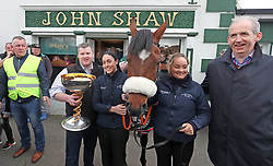 Trainer Gordon Elliot and Grand National Winner Tiger Roll pose for pictures with locals outside Shaw's Pub during the homecoming parade through Summerhill Village, County Meath.