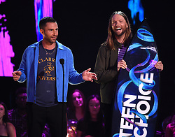 LOS ANGELES - AUGUST 13: Adam Levine (L) and James Valentine of Maroon 5 accept the Decade Award  onstage at FOX's 'Teen Choice 2017' at the Galen Center on August 13, 2017 in Los Angeles, California. (Photo by Frank Micelotta/FOX/PictureGroup) *** Please Use Credit from Credit Field ***