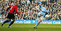 Photo. Aidan Ellis.<br /> Manchester City v Manchester United.<br /> FA Barclaycard Premiership.<br /> 14/03/2004.<br /> City's Jon Macken scores the second goal