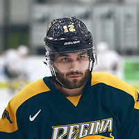 2nd year forward, Corwin Stevely (12) of the Regina Cougars during the Men's Hockey Home Game on Sat Jan 26 at Co-operators Center. Credit: Arthur Ward/Arthur Images
