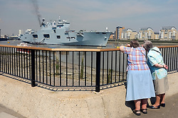 © Licensed to London News Pictures. 25/07/2012. London, UK .  People watch HMS Ocean moored in the Thames for the Olympic games 2012 in the sunshine as temperatures reach 30 degrees at Greenwhich Pier in London today 25 July 2012. Photo credit : Stephen Simpson/LNP