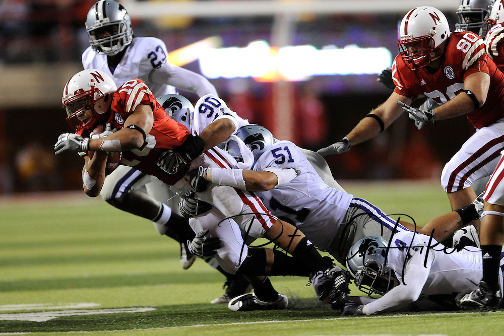 November 21, 2009: Defenders Eric Childs #90 and Ulla Pomele #51 of the Kansas State Wildcats tackle running back Roy Helu Jr. #10 of the Nebraska Cornhuskers for a loss in the fourth quarter at Memorial Stadium in Lincoln, Nebraska.
