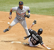 CHICAGO - JUNE 08:  Placido Polanco #14 of the Detroit Tigers turns a double play over the sliding Scott Podsednik #22 of the Chicago White Sox in the third inning on June 8, 2009 at U.S. Cellular Field in Chicago, Illinois.  The Tigers defeated the White Sox 5-4.  (Photo by Ron Vesely)