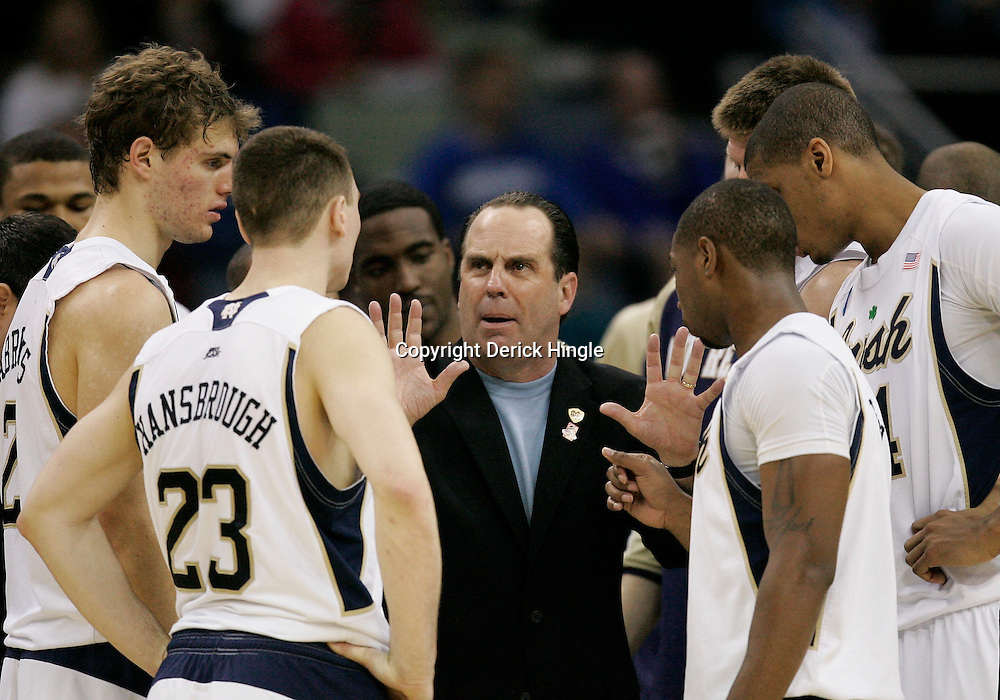 Mar 18, 2010; New Orleans, LA, USA; Notre Dame Fighting Irish head coach Mike Brey talks to his player during the second half against the Old Dominion Monarchs in the first round of the 2010 NCAA mens basketball tournament at New Orleans Arena. Old Dominion defeated Notre Dame 51-50. Mandatory Credit: Derick E. Hingle-US PRESSWIRE.