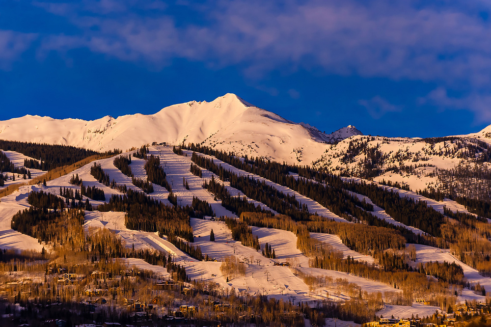 Ski slopes at Aspen/Snowmass ski resort at sunrise, Snowmass Village, Colorado USA.