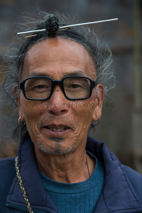 Apatani man showing hair knot. Skewer or Piidin Khotu is used to impale the hair knot.<br /> Apatani Tribe<br /> Ziro Valley, Lower Subansiri District, Arunachal Pradesh<br /> North East India