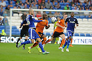 Benik Afobe of Wolverhampton Wanderers © challenges Matthew Connolly of Cardiff city. Skybet football league championship match, Cardiff city v Wolverhampton Wanderers at the Cardiff city stadium in Cardiff, South Wales on Saturday 22nd August 2015.<br /> pic by Andrew Orchard, Andrew Orchard sports photography.