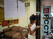 """26 JUNE 2015 - BANGKOK, THAILAND:  People file out of the Foreign Correspondents' Club of Thailand after Thai police cancelled the release of a Human Rights Watch (HRW) report, """"Persecuting 'Evil Way' Religion: Abuses against Montagnards in Vietnam"""", at the Foreign Correspondents' Club of Thailand (FCCT) in Bangkok Friday morning. The report made no mention of the human rights situation in Thailand. The Thai Ministry of Foreign Affairs (MFA) contacted HRW Thursday afternoon and asked them to cancel the program because it was a """"sensitive"""" matter that could impact on Thai-Vietnam relations. HRW told the MFA that they would go ahead with the report's release. Friday morning, before the report was scheduled to be released, Thai police officers arrived at the FCCT and cancelled the event. Phil Robertson, deputy director of Human Rights Watch's Asia division, said, """"By stepping in to defend a neighboring state's human rights violations against a group of its people and interrupting a scheduled press conference, Thailand's military junta is violating freedom of assembly and demonstrating its contempt for freedom of the press.""""      PHOTO BY JACK KURTZ"""