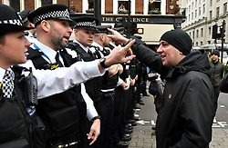 A demonstrator argues with police officers as Pro-Brexit demonstrators attempt to get into Trafalgar Square, London, where a rally organised by the People's Assembly Against Austerity are gathered.