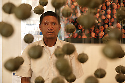 Mr. Ta suffered damage to eyes and limbs from a UXO accident and can be seen here with part of the COPE exhibition centre which displays used items of UXO (unexploded Ordnance) and the prosthetic limbs either locally made or made by the centre, Vientiane, Lao PDR