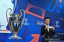 NYON, SWITZERLAND - Monday, December 17, 2018: Former Liverpool player and Champions League winner Luis Garcia holds up Borussia Dortmund after making the draw during the UEFA Champions League 2018/19 Round of 16 draw at the UEFA House of European Football. (Handout by UEFA)