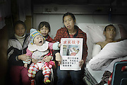 FUZHOU, CHINA - DECEMBER 14: (CHINA OUT) <br /> <br /> Woman Sells Daughters To Save Husband<br /> <br /> Ni Xiong, a 34-year-old woman wanted to sell her under one-year-old daughter to save her badly injured husband Zhou Xinggui, who was injured by falling from third floor during working at a construction site. Zhou's boss escaped after his injury and the homeowner paid 7,000 RMB (about 1,130 USD) as compensation and no longer answered Ni's call. Zhou needed money for his surgery but his family can't pay for the medical cost, so Ni Xiong wanted to sell her daughter and get some money for his husband's surgery. Persuaded by the reporter that day, Ni decided not to sell her daughter and would consider if there is any other way for her husband's surgery.<br /> ©Exclusivepix Media