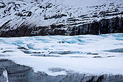 Group of tourists walking on adventure trek on Svinafellsjokull glacier an outlet glacier of Vatnajokull, South Iceland