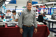 Jon Haes, senior director of pre-owned merchandising, poses for a photo at the GameStop retro classics console games refurbishment center in Grapevine, Texas on June 24, 2015. (Cooper Neill for Mashable)