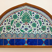 A polychrome lunette of glazed tiles from Iznik ca. 1575 in the Tiled Kiosk at the Istanbul Archaeology Museums. The Tiled Kiosk was commissioned by Sultan Mehmed II in 1472 and is one of the oldest buildings in Istanbul. It features Ottoman civil architecture, and was a part of the Topkapı Palace outer gardens. It was used as the Imperial Museum between 1875 and 1891 before the collection moved to the newly constructed main building. It was opened to public in 1953 as a museum of Turkish and Islamic art, and was later incorporated into the Istanbul Archaeology Museum. The Istanbul Archaeology Museums, housed in three buildings in what was originally the gardens of the Topkapi Palace in Istanbul, Turkey, holds over 1 million artifacts relating to Islamic art, historical archeology of the Middle East and Europe (as well as Turkey), and a building devoted to the ancient orient.