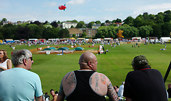 "© Licensed to London News Pictures. 13/07/2013<br /> <br /> Durham City, England, United Kingdom<br /> <br /> Men look out over the racecourse fields at the start of the Durham Miners Gala.<br /> <br /> The Durham Miners' Gala is a large annual gathering held each year in the city of Durham. It is associated with the coal mining heritage of the Durham Coalfield, which stretched throughout the traditional County of Durham, and also gives voice to miners' trade unionism. <br /> <br /> Locally called ""The Big Meeting"" or ""Durham Big Meeting"" it consists of banners, each typically accompanied by a brass band, which are marched to the old Racecourse, where political speeches are delivered. In the afternoon a Miners' service is held in Durham Cathedral <br /> <br /> Photo credit : Ian Forsyth/LNP"