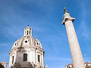 Trajan's Column with the dome of Santa Maria Di Loreto, Rome, Italy.