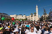 A busy Manger Square with runners ready for the Palestine Marathon on 1st April 2016 in Bethlehem, West Bank. During the Palestine Marathon, thousands of runners, both professional and amateur come from across the globe to take part in the Right to Movement event.