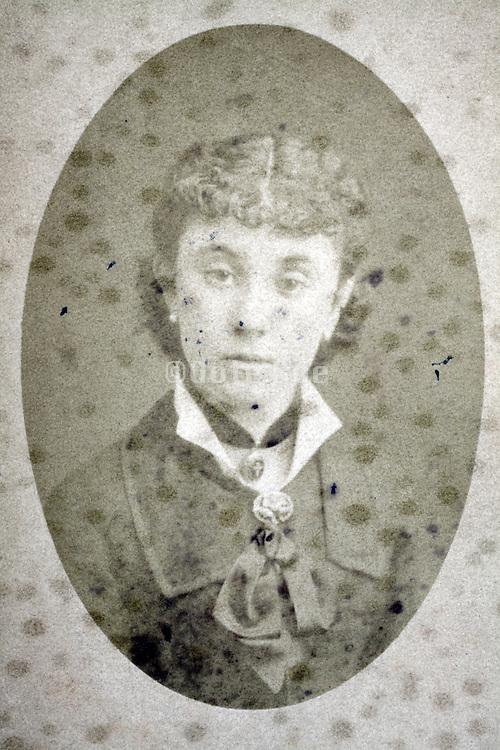 damaged studio portrait woman late 1800s