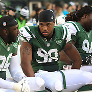 Quinton Coples, (centre), New York Jets, during the New York Jets Vs Miami Dolphins  NFL American Football game at MetLife Stadium, East Rutherford, NJ, USA. 1st December 2013. Photo Tim Clayton