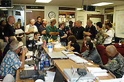 Governor of Mississipp Haley Barbour, forth from right, addresse the team gathered to respond to Hurricane Katrina in the war room at the Mississippi Emerengcy Managemant Agency headquarters in jackson  Mississippi the moring of the storm August 29,2005.