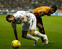 Photo: Ed Godden.<br />Wolverhampton Wanderers v Norwich City. Coca Cola Championship. 23/12/2006. Norwich's Darren Huckerby (L), is tackled by Mark Little.