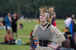 A LGBTI+ protester attends a Queer Picnic in Hyde Park following the first-ever Reclaim Pride march on 24th July 2021 in London, United Kingdom. Reclaim Pride replaced the traditional Pride in London march, which many feel has become too commercial and strayed from its roots in protest, and was billed as a People's Pride march for LGBTI+ liberation. Campaigners called for the banning of LGBTI+ conversion therapy, the reform of the Gender Recognition Act, the provision of a safe haven for LGBTI+ refugees and for LGBTI+ people to be decriminalised worldwide and marched in solidarity with Black Lives Matter.